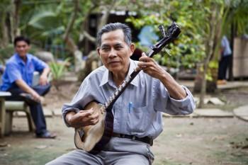 Musicien, delta du Mekong, Vietnam